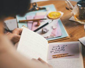 Woman opening journal