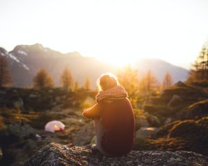 Backpacker in wilderness watching sunset