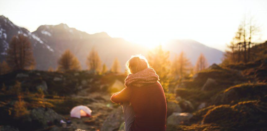 Backpacker in wilderness watching sunset