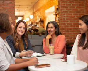 Women at a coffee shop meeting